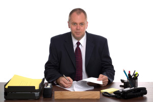 Business Manager At His Desk